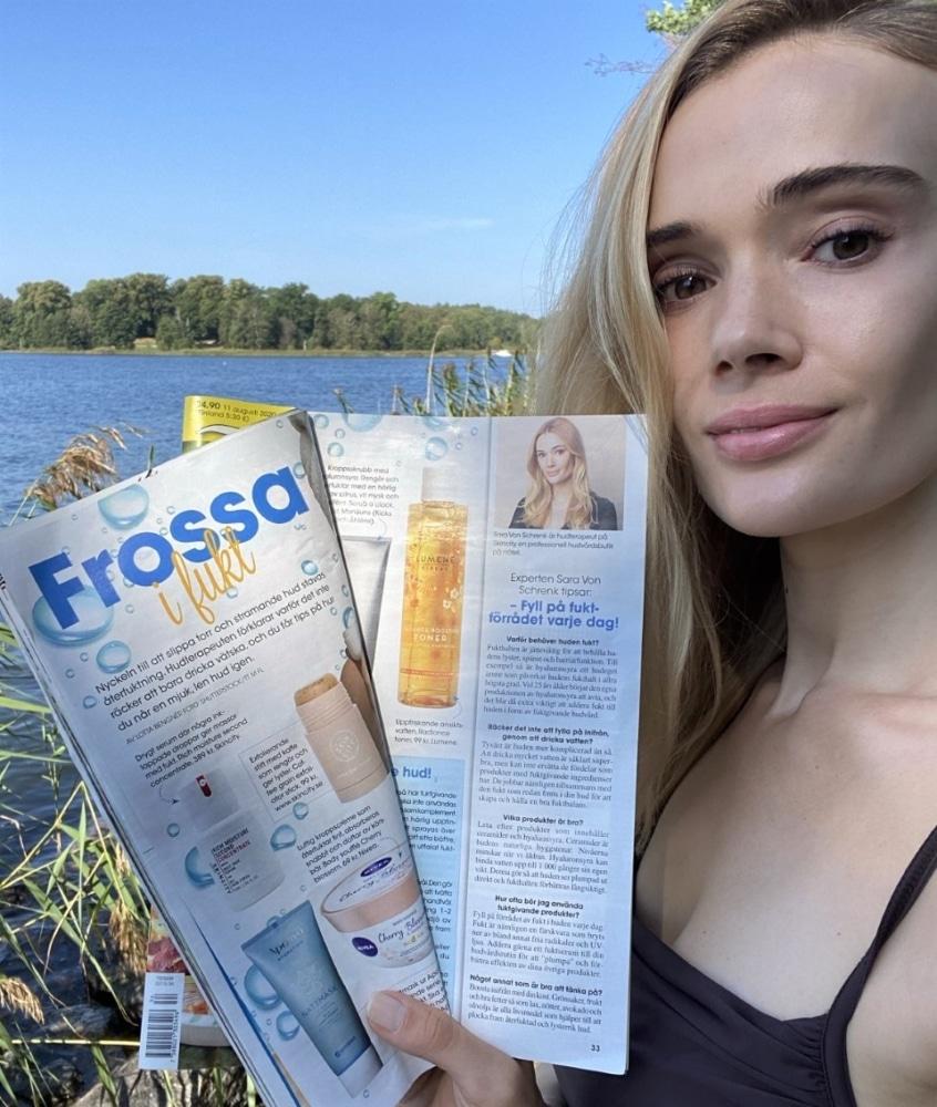 Sara med tidning